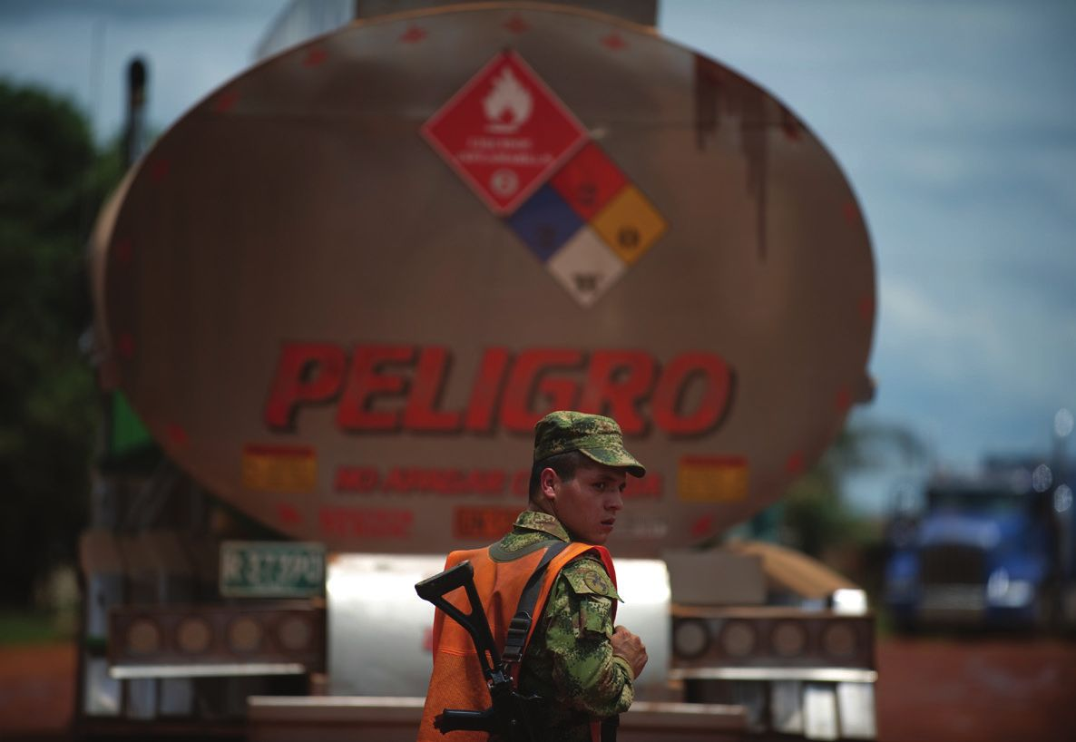 """A soldier stands by a bulk liquid carrier at a checkpoint in the outskirts of Puerto Gaitan, Meta department, eastern Colombia, on October 8, 2011. Colombia, 2011 © AFP PHOTO/Eitan Abramovich"""" title=""""A soldier stands by a bulk liquid carrier at a checkpoint in the outskirts of Puerto Gaitan, Meta department, eastern Colombia, on October 8, 2011. Colombia, 2011 © AFP PHOTO/Eitan Abramovich"""