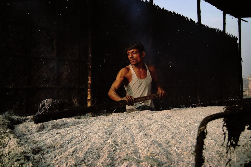 """A worker boils leftover scraps of chemically soaked leather trimmings. The contaminated leather is then left to dry on the ground and is eventually used to feed livestock. © Daniel Lanteigne"""" title=""""A worker boils leftover scraps of chemically soaked leather trimmings. The contaminated leather is then left to dry on the ground and is eventually used to feed livestock. © Daniel Lanteigne"""